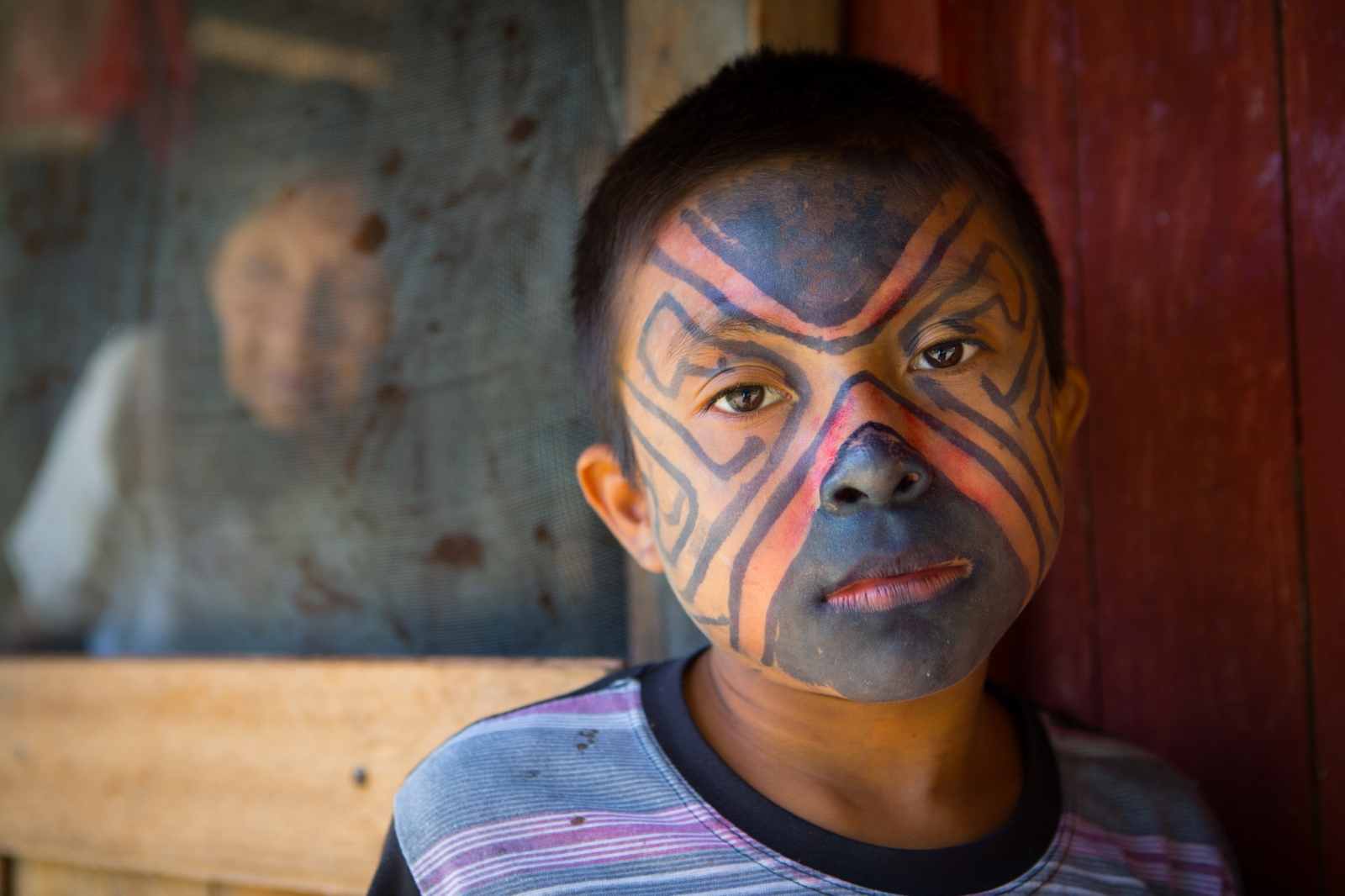 Indigenous boy in Santa Rey, Peru. From an assignment with Science Magazine looking at the social and environmental issues affecting isolated tribes in and around the Alto Purús National Park, Peru.