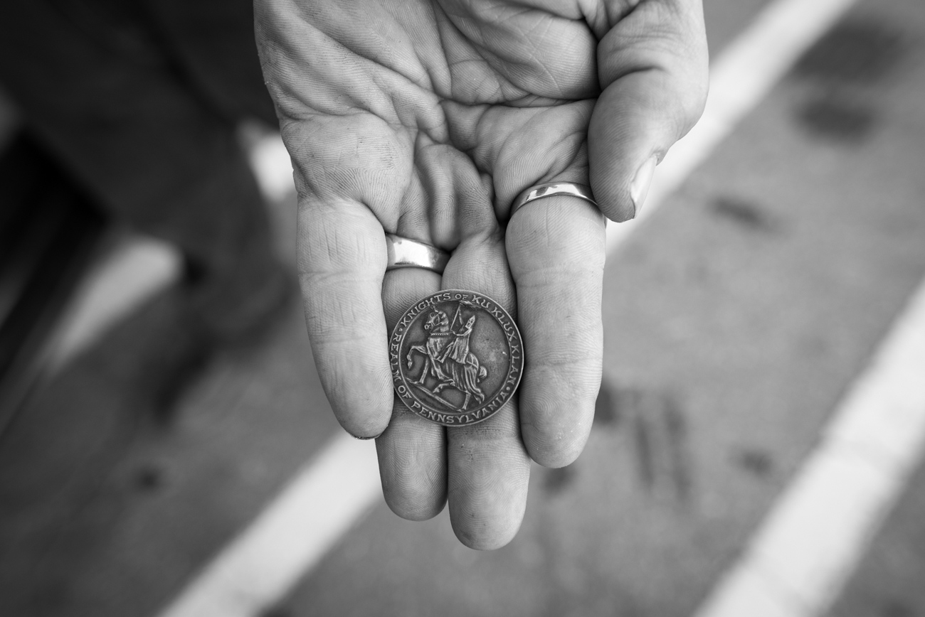 Chattooga County, GA 12/12/2015. A Klansman displays a coin from his collection of Klan collectables. The coin was used to signify a member in good standing. This particular coin was said to be from 1923.