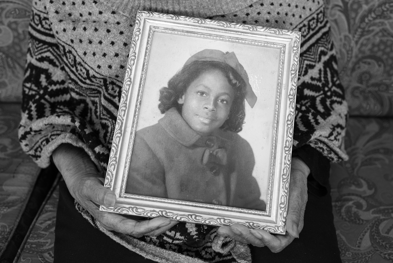 Mrs. Maxine McNair holding a photograph of her daughter Denise. Denise McNair was one of the 4 girls killed when the 16th St. Baptist Church in Birmingham, Alabama was bombed in 1963.