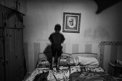A view of the children's bedroom of a poor, unemployed family in the Palmete neighborhood of Seville.