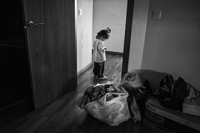 A child of an unemployed family inside a newly constructed building expropriated by a bank and occupied by homeless families in Corrala La Utopia, Seville.
