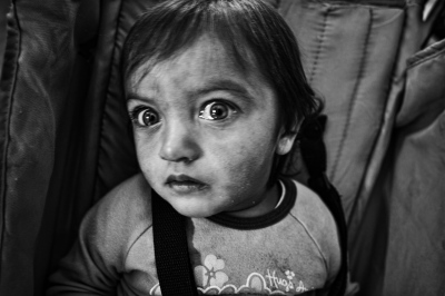 A child from an unemployed family without means is attended to and looked after at the Maria Angeles Nursery, Aliento Association, in a shantytown of Seville.