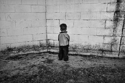 A child of Roma ethnic origin stands in the playground of Menendez Pidal School in a depressed neighborhood of Seville.