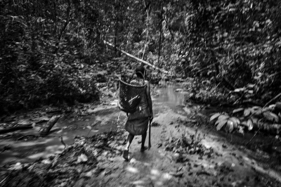 A baka pygmie woman fishing along the river near the village of Bosquet, Dja Faunal Reserve.