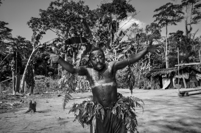 A baka pygmie man dances under the influence of alcohol in the village of Mantisone, Dja Faunal Reserve.
