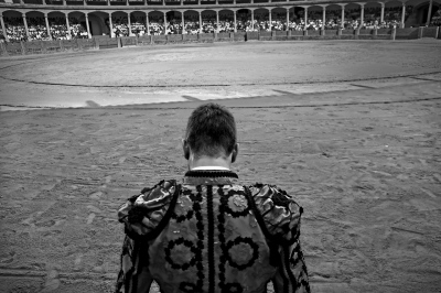 The bullfighter Jose María Manzanares at concentrated prayer moments before beginning the fight. Ronda.
