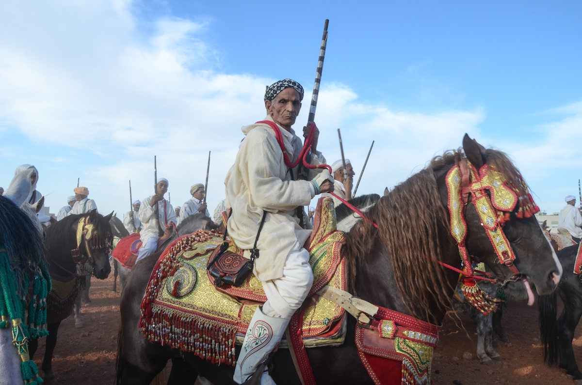A seasoned and proud fantasia rider poses stoically atop his horse in the trooping of the sorbas ( riding teams). Seffrou, Morocco