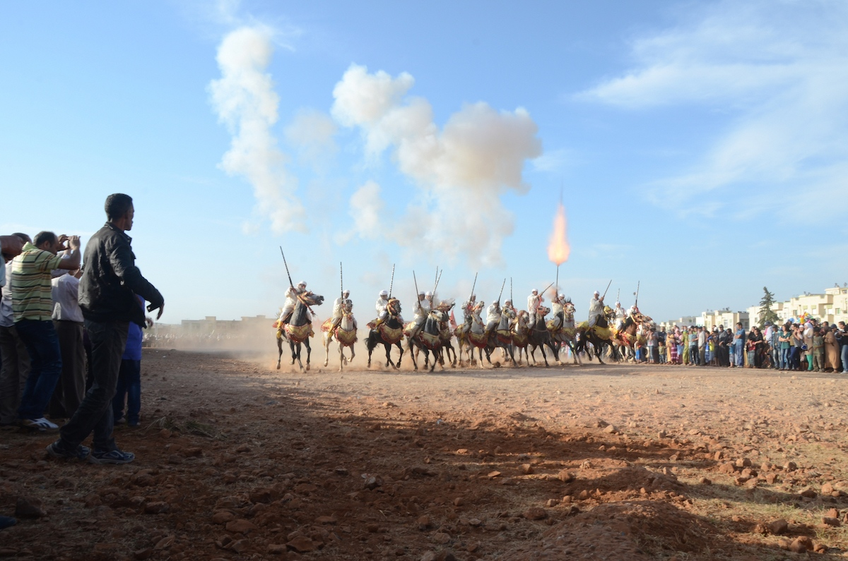 Gunpowder smoke and muzzle blasts as the sorba ( riding team) end its charge.  Seffrou, Morocco
