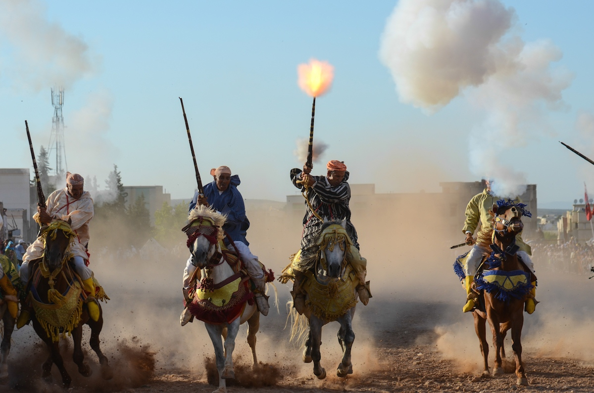 Riders , horses and dust , end their charge, Seffrou, Morocco