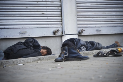 Aroon (11, visible face), sleeps outside of a local electronic store together with friends. He escaped from home four years ago, because his parents abused him.