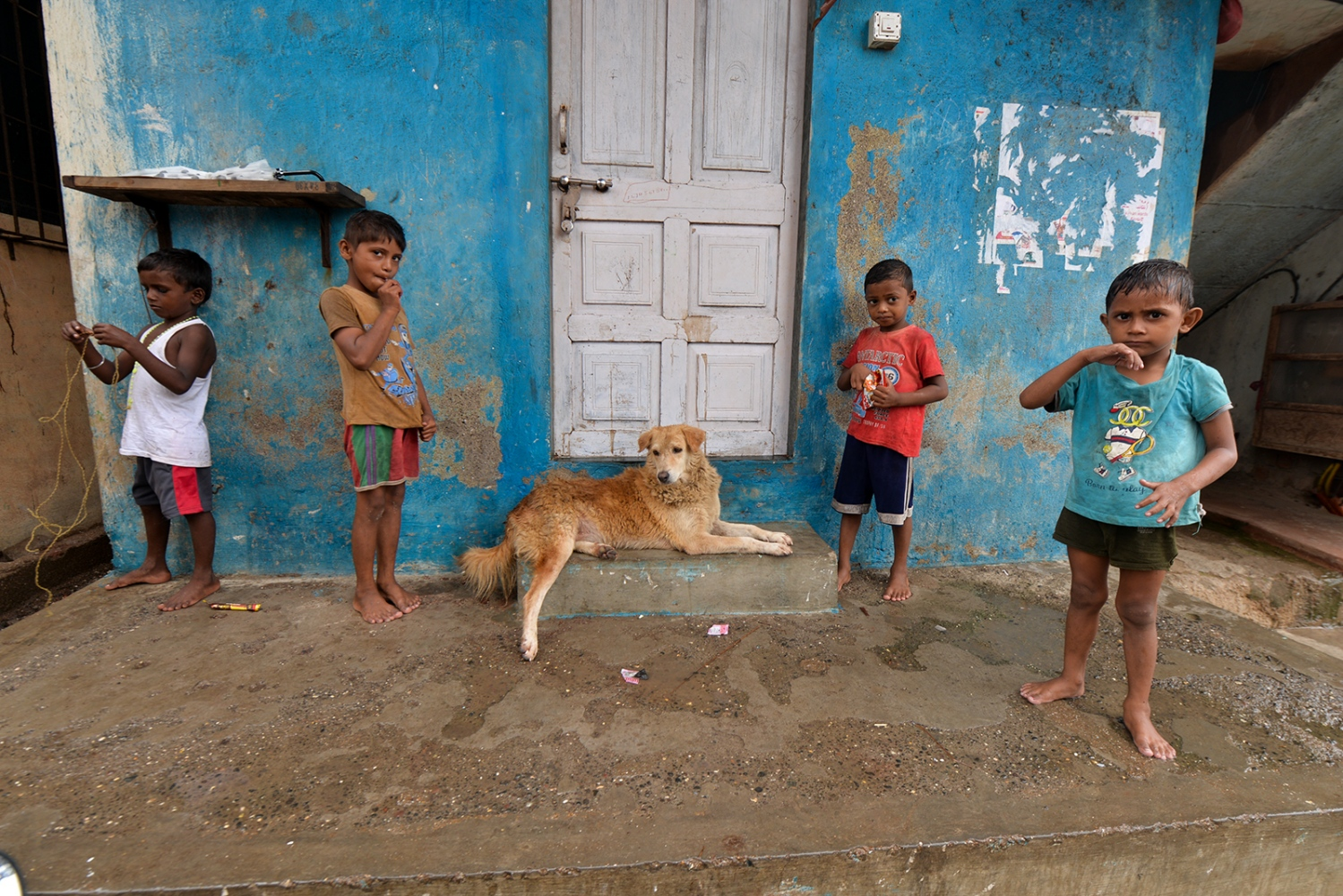 Children and dog. Versova village. Mumbai, India.