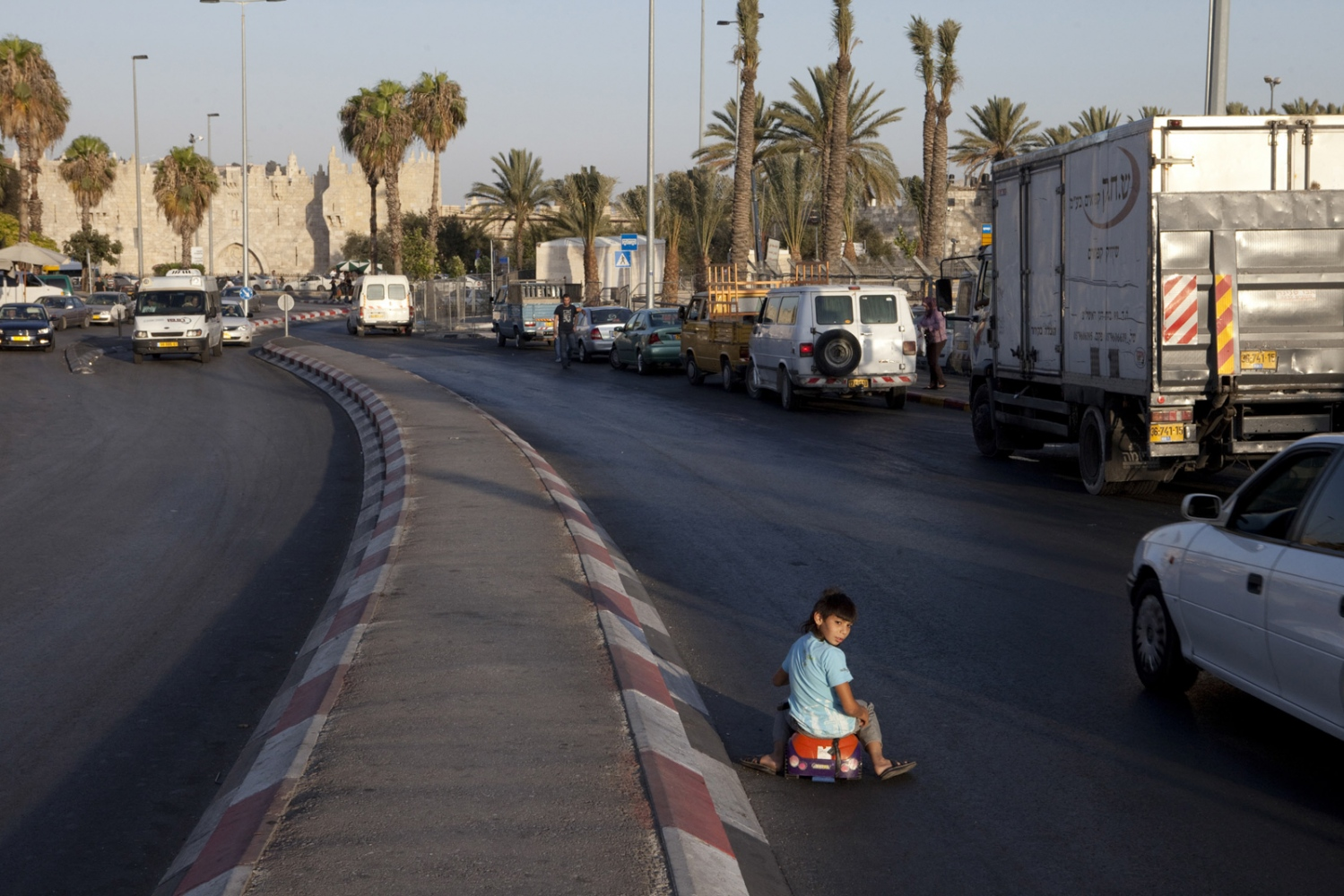 The Damascus Gate of Jerusalem's Old City marks the beginning of Palestinian East Jerusalem. The Child in the road sits on the old Jordanian front line, to his right, 100 metres of no-man's land, before Jewish West Jerusalem.