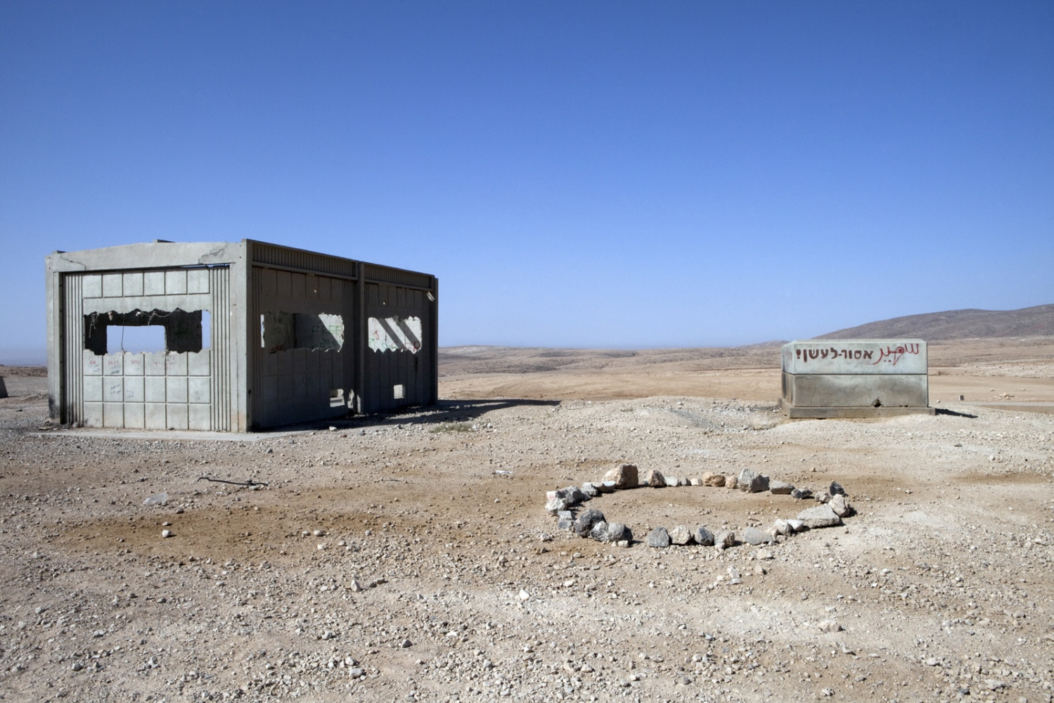 An abandoned IDF base sitting on the Green Line; which runs to the south Hebron Hills in the distance