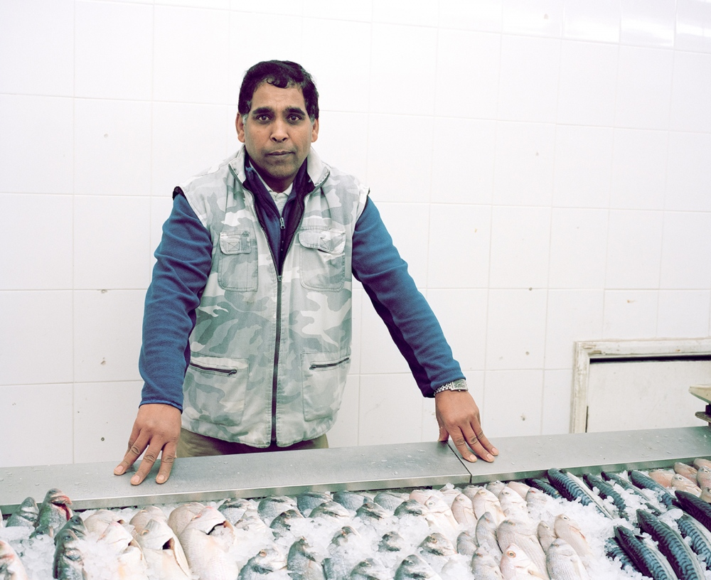 Mohammed Asghar owns Shaba, the fishmongers closest to Seven Sisters station. Despite being the boss he always seems to be busy serving customers and helping his employees. M. Asghar doesn't speak much to me, but is happy to have his photograph taken.