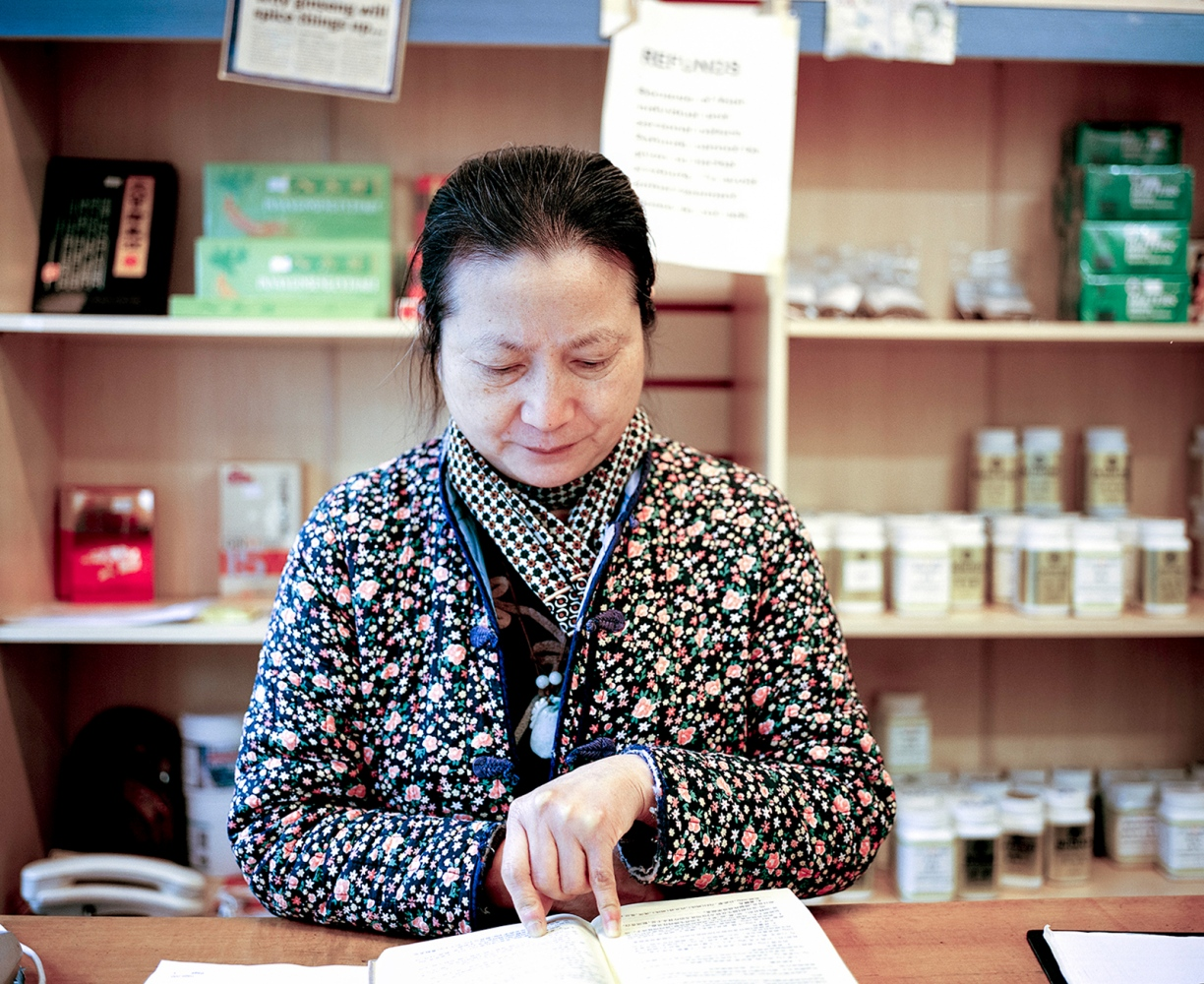 Ling Han owns Chang Jiang Chinese Medicines, which has been on the road for twenty years. Ling tells me she is happy to have a photograph taken as she likes to support the younger generation.