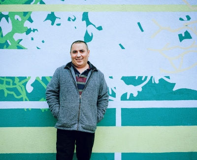 Mehmet Guler runs Gunaydin Super Market on the corner of West Green Road and Lawrence Road. Mehmet stands in front of the mural that has been painted on the shop exterior. We don't speak each others languages, so not too much is said.