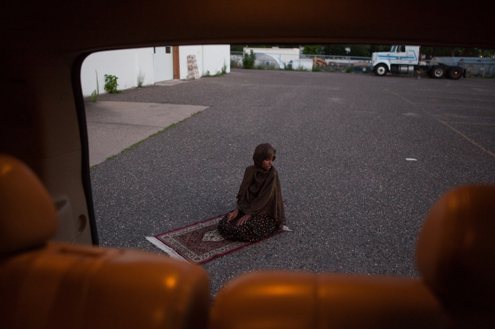 Fartun Mahamoud Abdi prays in the parking lot of a building where she will be opening a new day care center catering to Somali children in a suburb of Minneapolis. Ms. Abdi is also currently earning her PhD in radicalization studies, focusing her research on the Somali community in Minneapolis.