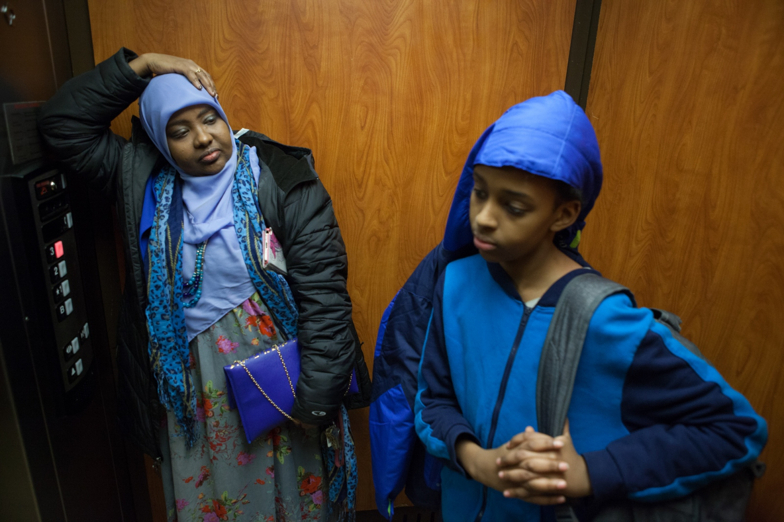 Saciido Shaie arrives home with her 13-year-old son after picking him up from school. Ms. Shaie worries that her son's sense of identity and belonging in the US will be harmed by increasing anti-Muslim rhetoric.