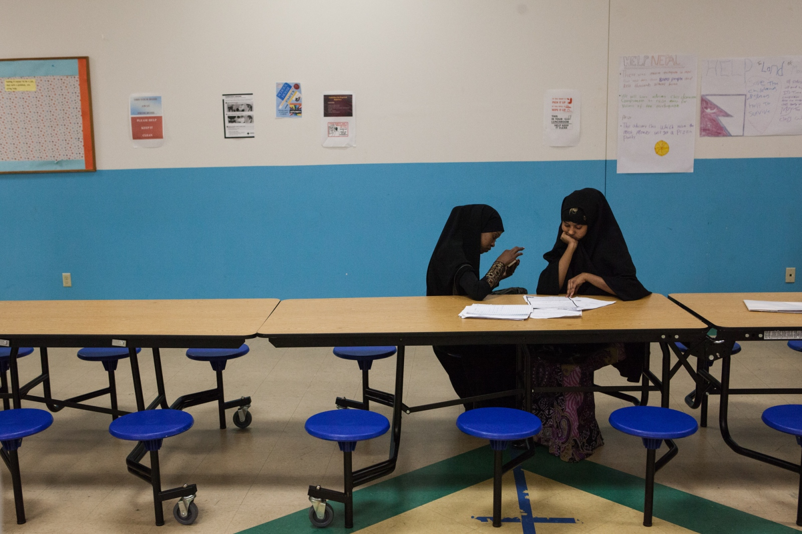 Two girls use their lunch break to study at Lincoln International High School in Minneapolis. Somali parents are attracted to charter schools like Lincoln, where most students are Somali, because they feel it will help their kids preserve their culture.