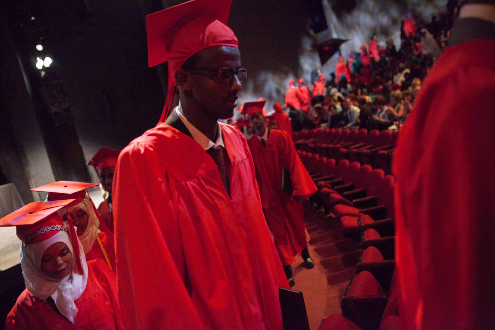 Graduating senior Mahamed Ahmed leaves at the end of the Lincoln International High School commencement ceremony. Lincoln is one of a number of charter schools in Minneapolis with a predominantly Somali student body.