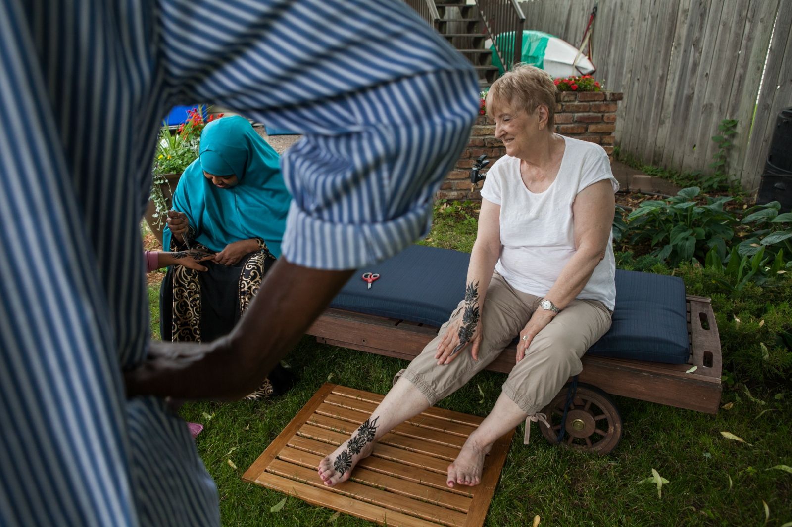 Sharon Albee waits for the henna temporary tattoos on her hand to dry. Henna is a popular decoration Somalis adorn themselves with for special events like weddings or, in this case, Iftar dinner.