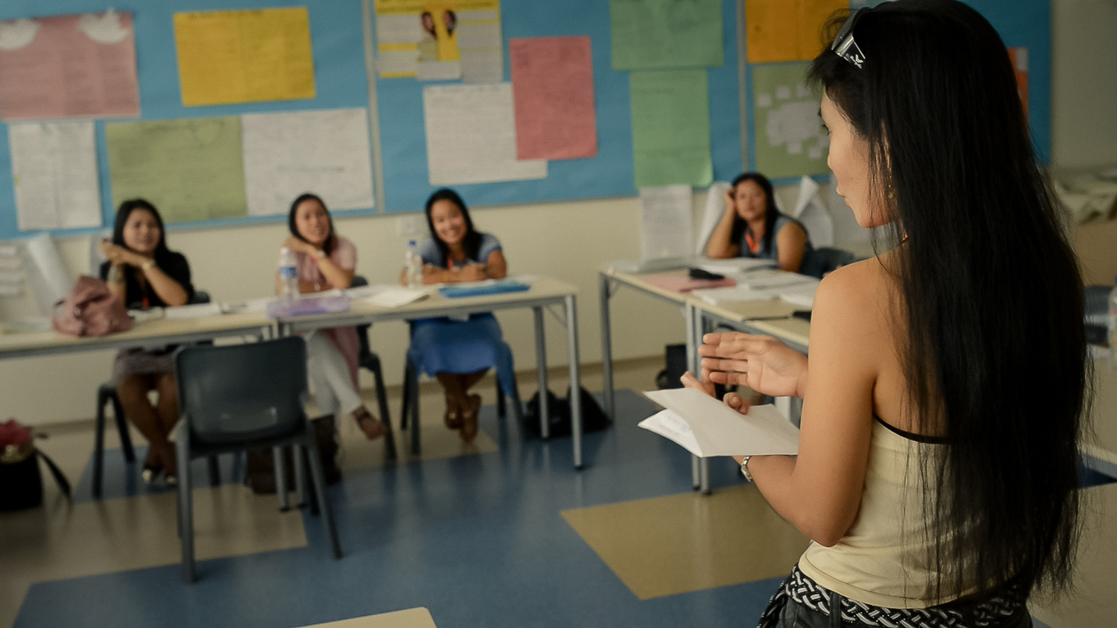 A Foreign domestic worker gives a presentation in a class at 'Aidha' - a business school for domestic workers in Singapore.