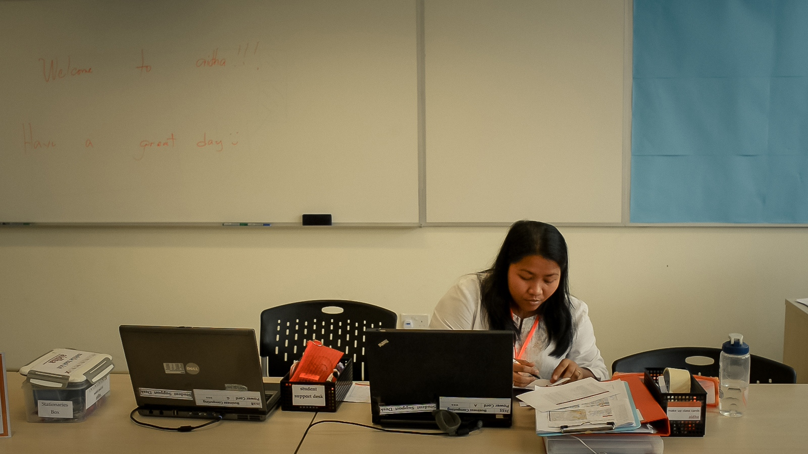 Janelyn Pascua from the Philippines in a school classroom which serves as a temporary office for 'Aidha' - a business school for domestic workers in Singapore. 'Jena' works as a domestic worker and volunteers with Aidha during some of her days off. She has a farm in the Philippines which she runs with her husband. The money she earns in Singapore is invested in her business in the Philippines. Prior to volunteering with Aidha, she studied business management with the organisation.