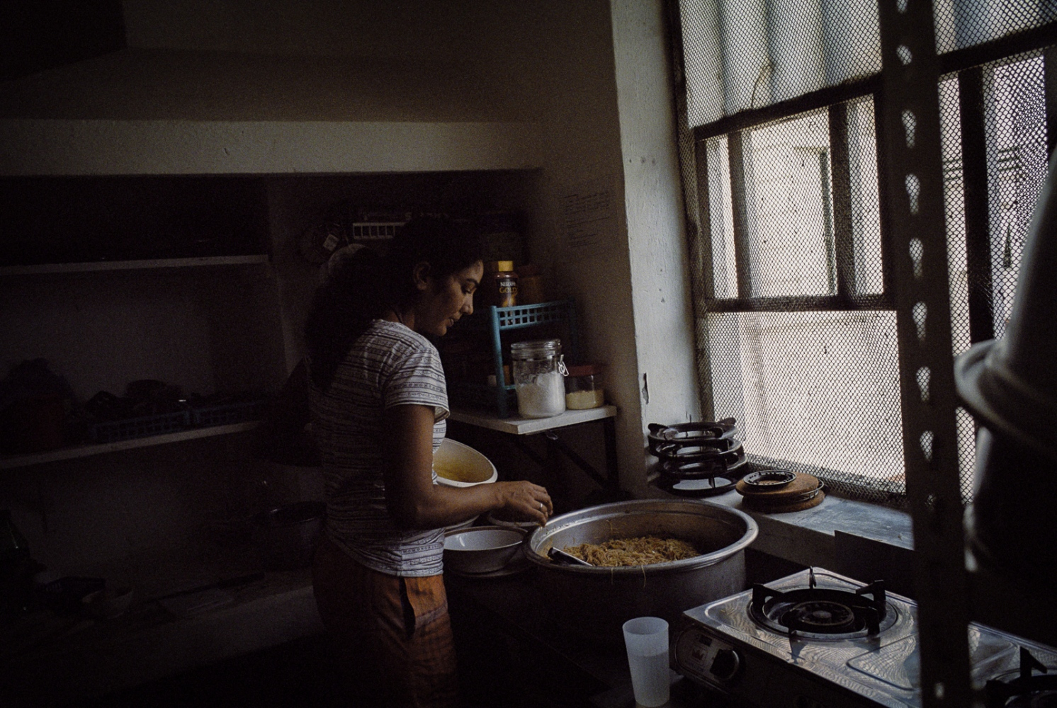 A Foreign domestic worker housed at a shelter run by The Humanitarian Organisation for Migration Economics (HOME), an organisation that provides direct assistance to men and women migrants and victims of human trafficking and forced labour. Abuse of domestic workers ranges from physical and verbal abuse, sexual assault, punative action for perceived wrongs, violation of contracted rights and witheld pay. As Foreign domestic workers in Singapore are required by law to live with their employer, many who suffer abuses feel they have no choice but to run away and seek shelter with their embassy or NGOs such as HOME.