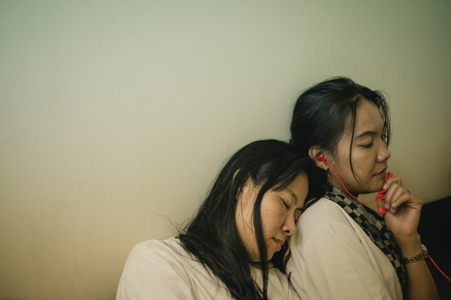 Foreign domestic workers wait for their cases to be assessed after seeking refuge with The Humanitarian Organisation for Migration Economics (HOME), an organisation that provides direct assistance to men and women migrants and victims of human trafficking and forced labour. Abuse of domestic workers ranges from physical and verbal abuse, sexual assault, punative action for perceived wrongs, violation of contracted rights and witheld pay. As Foreign domestic workers in Singapore are required by law to live with their employer, many who suffer abuses feel they have no choice but to run away and seek shelter with their embassy or NGOs such as HOME.