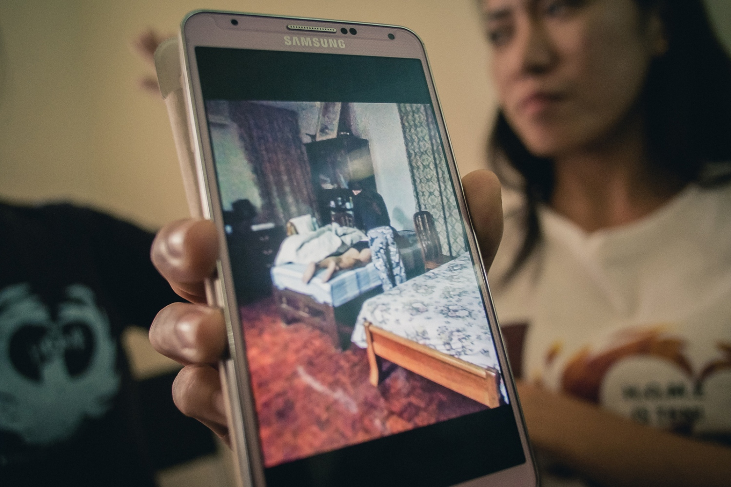 A foreign domestic worker in Singapore shows a photograph depicting what she claims is her giving her male employer a massage, which was requested by him and which she felt unable to refuse. Because of this and other alleged abuses she ran away from her employer and sought refuge with The Humanitarian Organisation for Migration Economics (HOME), an organisation that provides direct assistance to men and women migrants and victims of human trafficking and forced labour. She states the photograph was taken by another foreign domestic worker who also worked for the same employer. Foreign domestic workers in Singapore are required by law to live with their employer.Becasue of this, many who suffer abuses feel they have no choice but to run away and seek shelter with their embassy or NGOs such as HOME.Many domestic workers are asked to perform tasks that are outside their job description, are dangerous or simply inappropriate and feel unable to refuse for fear of being penalised, punished or fired. Abuse of domestic workers ranges from physical and verbal abuse, sexual assault, punative action for perceived wrongs, violation of contracted rights and witheld pay.