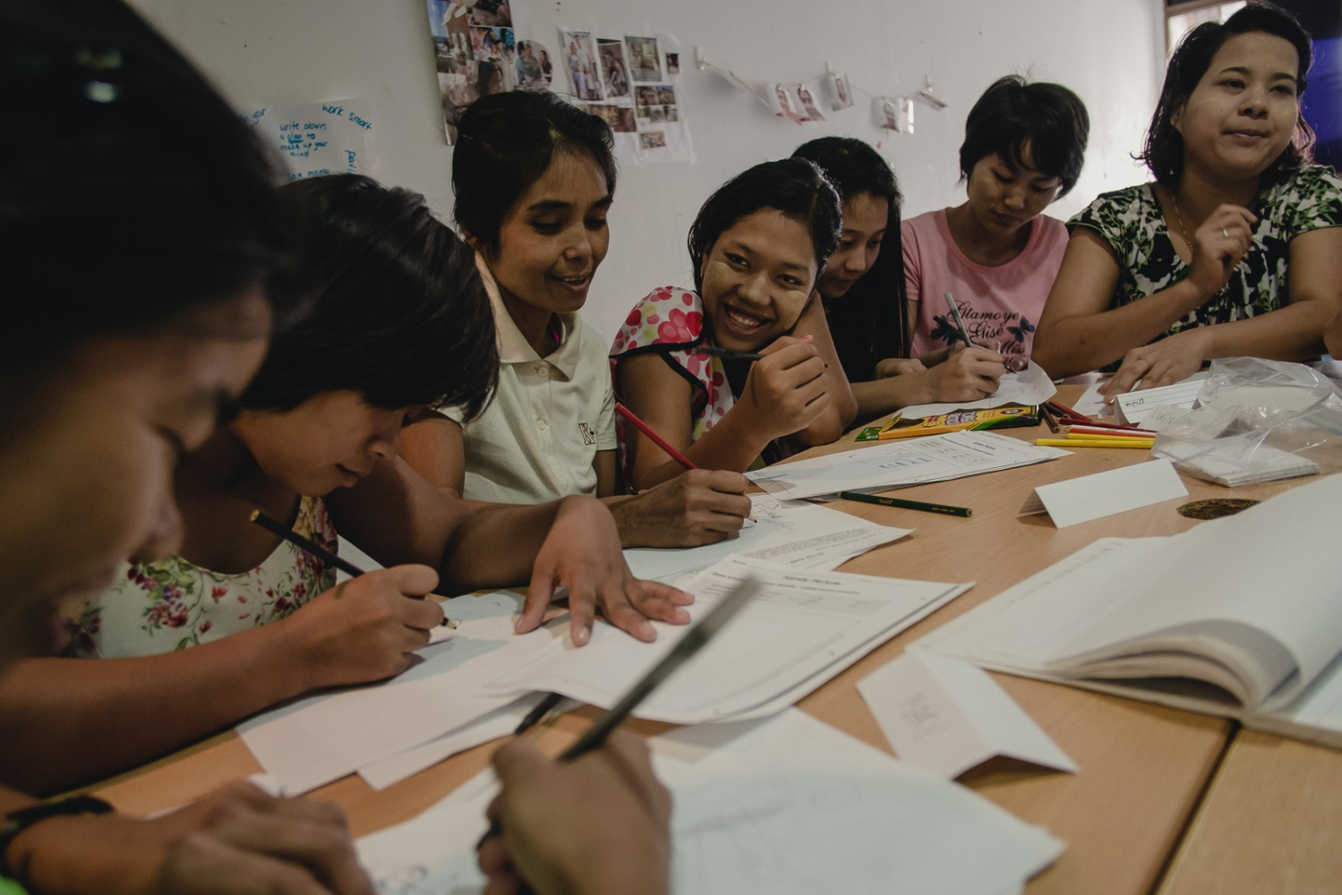 Foreign domestic workers take an english language course while housed at a shelter run by The Humanitarian Organisation for Migration Economics (HOME), an organisation that provides direct assistance to men and women migrants and victims of human trafficking and forced labour. Abuse of domestic workers ranges from physical and verbal abuse, sexual assault, punative action for perceived wrongs, violation of contracted rights and witheld pay. As Foreign domestic workers in Singapore are required by law to live with their employer, many who suffer abuses feel they have no choice but to run away and seek shelter with their embassy or NGOs such as HOME.
