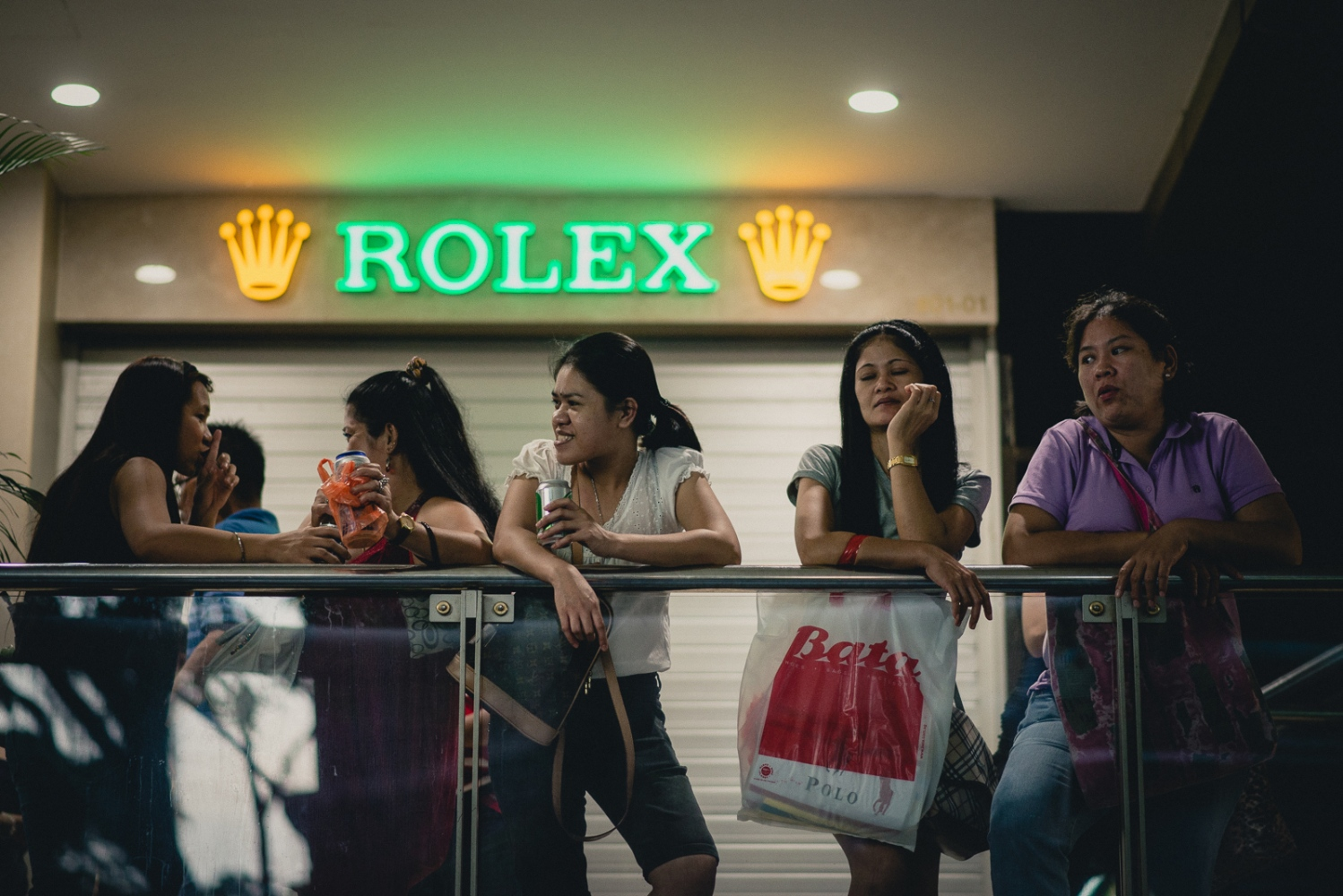 Singapore. Foreign domestic workers on their day off congregate outside the Lucky Plaza shopping centre along Orchard Road, one of the most popular shopping streets in Singapore.