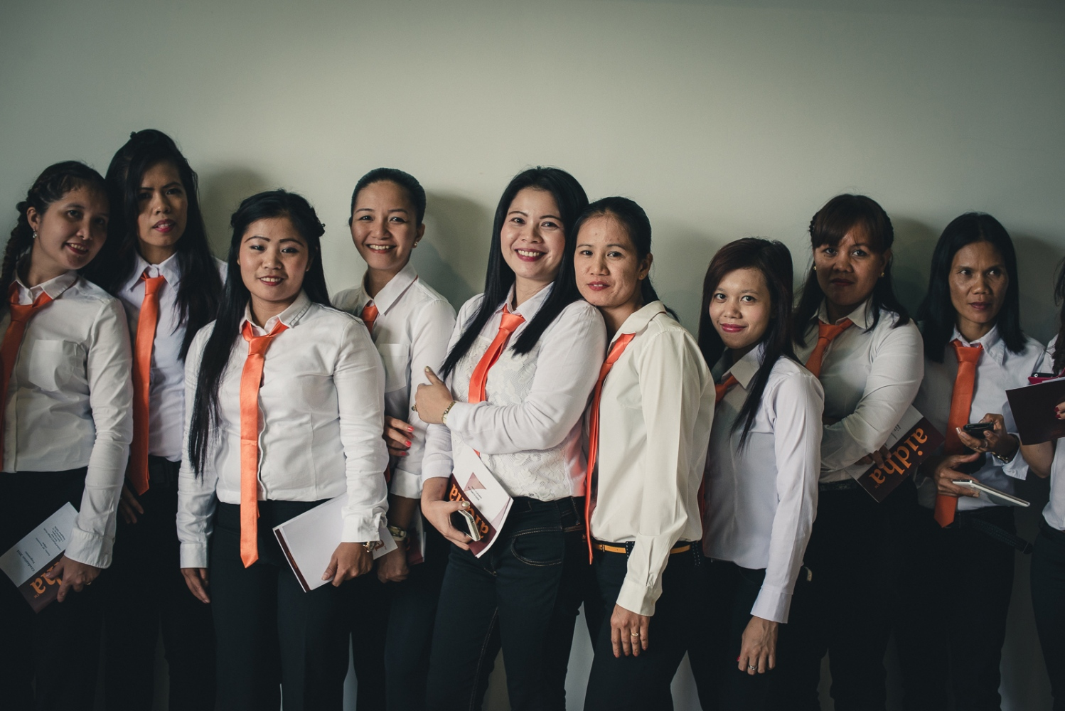 Foreign domestic workers pose on the occasion of their graduation ceremony from Aidha, a micro business school for foreign domestic workers in Singapore.
