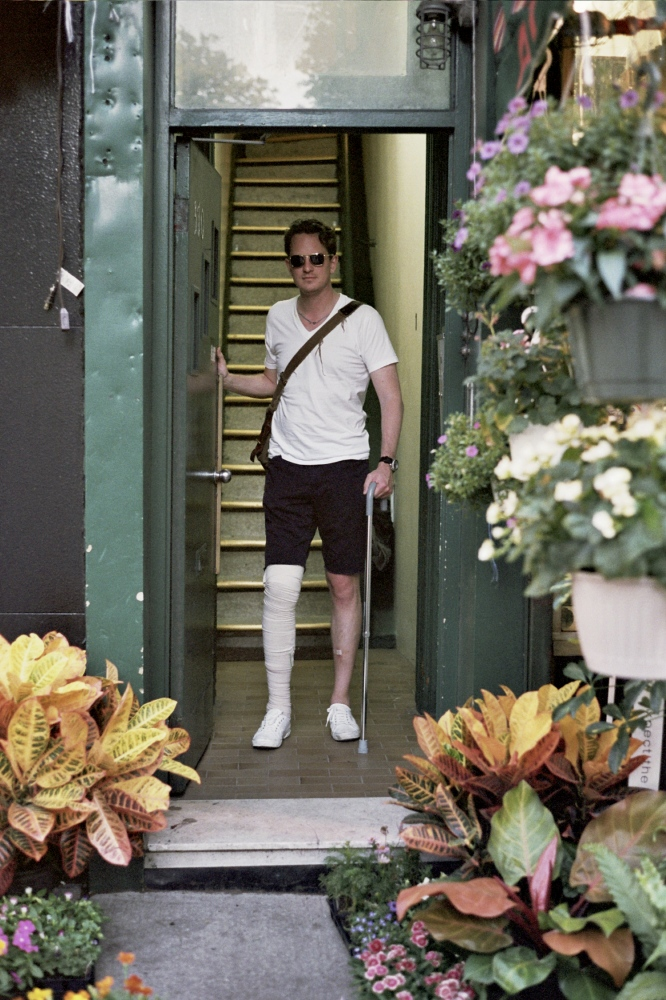 Jason in his doorway after the accident, New York, NY