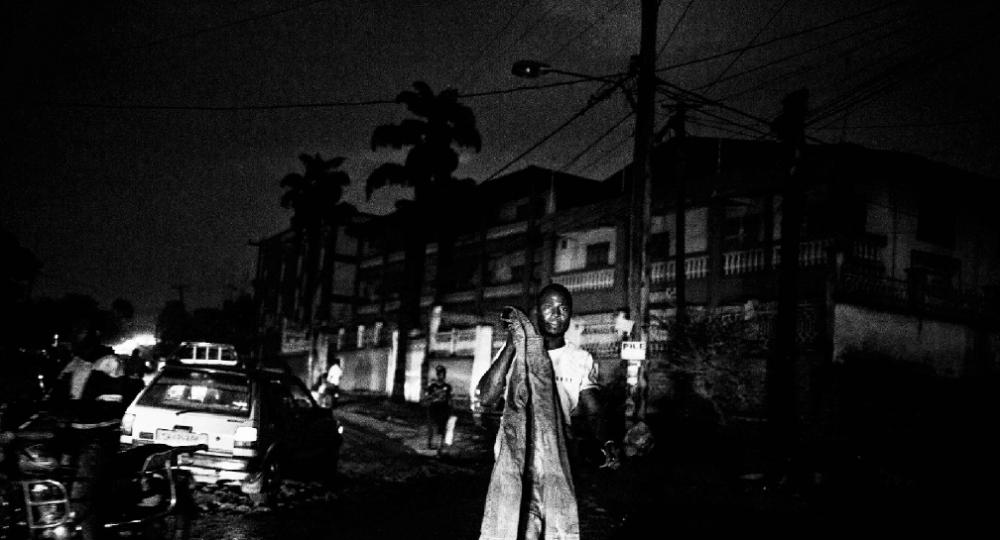 Bamenda, Cameroon. Night falls on Nkwen Street