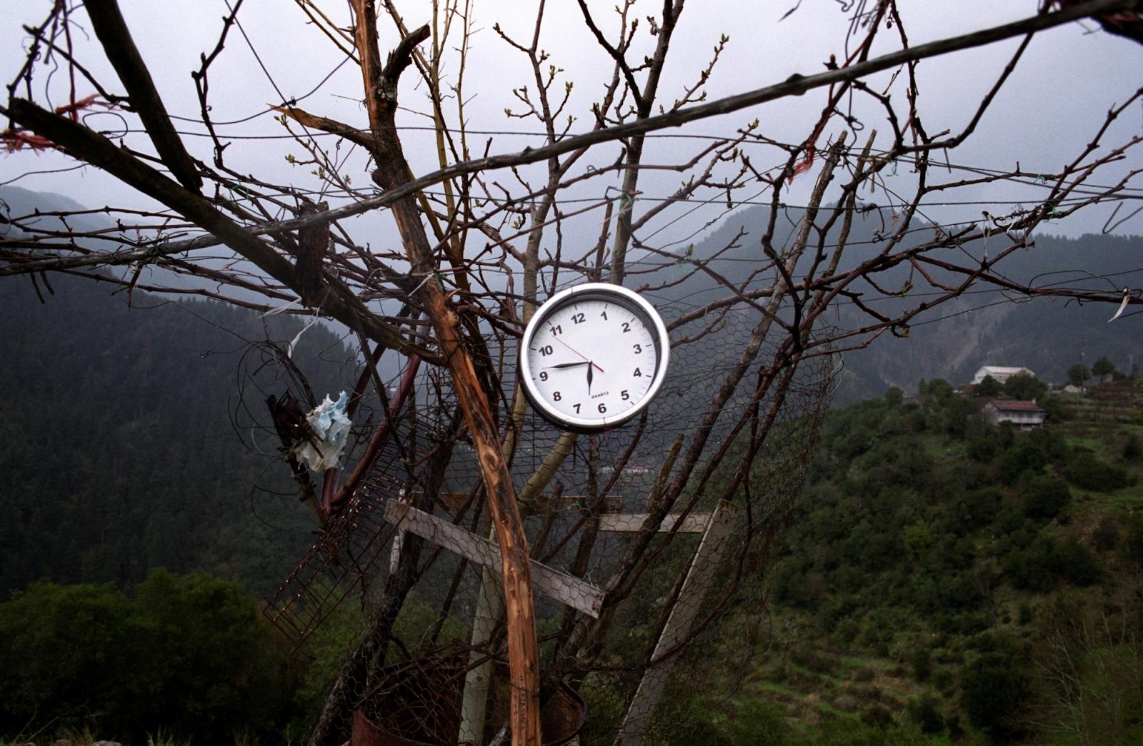 Roadside clock. Near Karpenissi, central Greece.