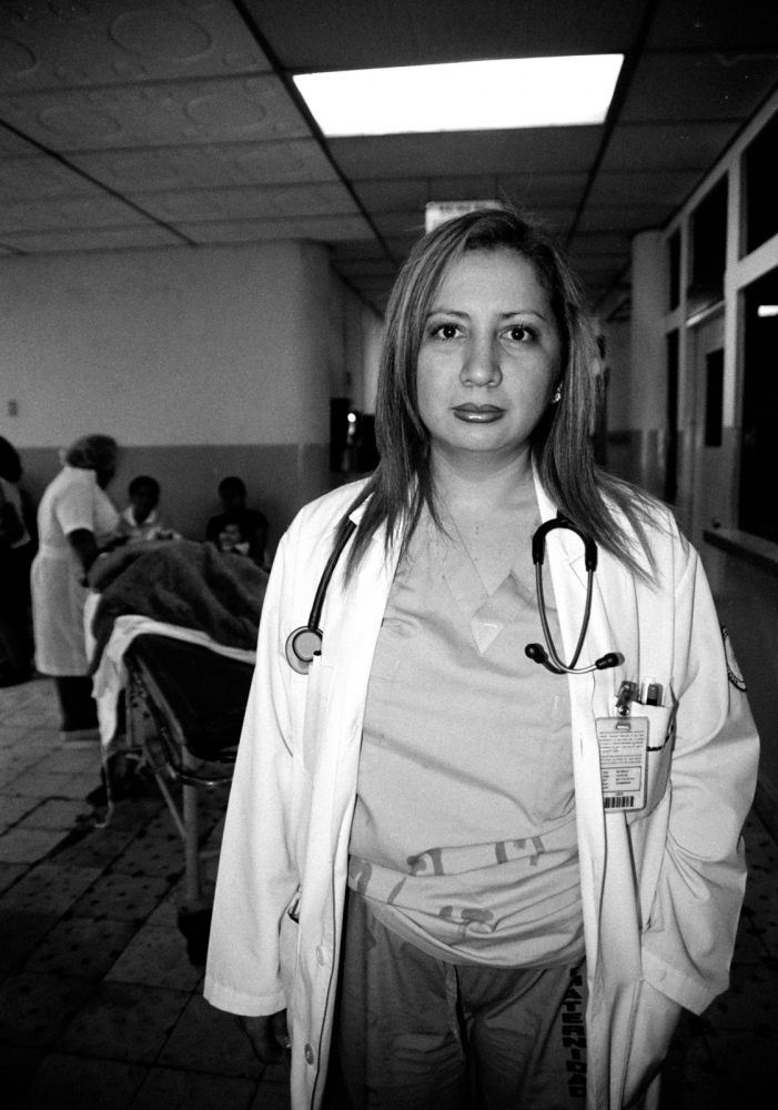 "Carmen Vargas, chief of OB/GYN residents at a maternity hospital in San Salvador. ""When we see physical evidence,"" she says, ""we are required to report."" 2006"