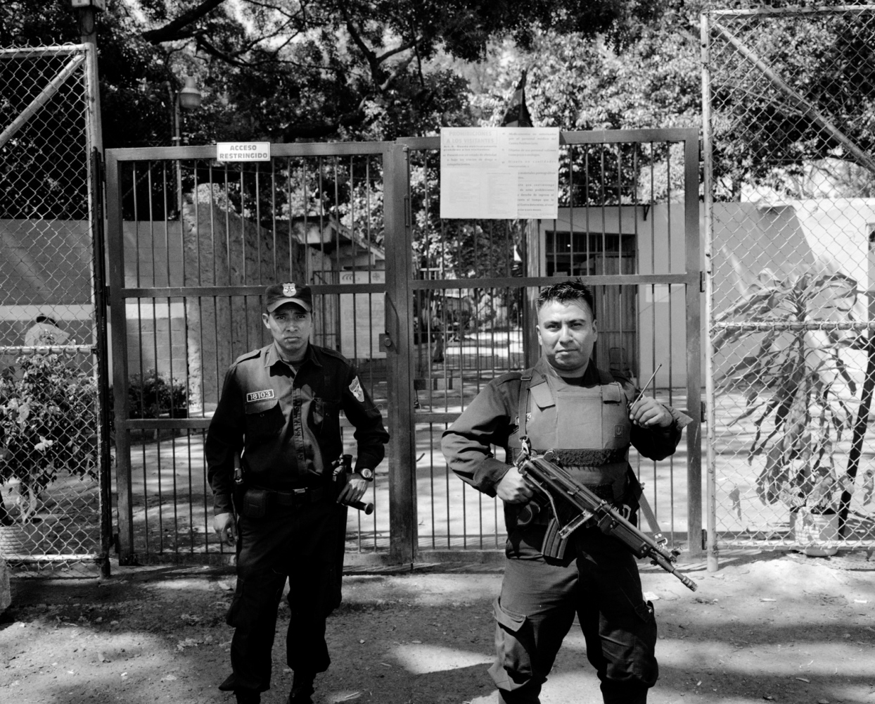 Guards stand outside the prison where Carmen Climaco was being held. Climaco was given 30 years for an abortion that was ruled a homicide. 2006