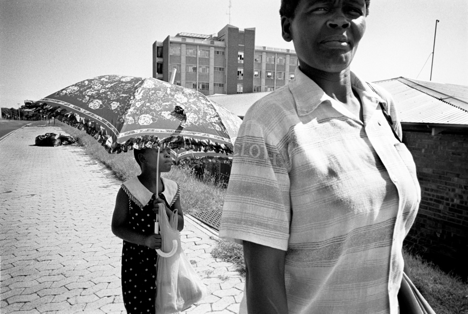 The long and usually futile process of trying to get a conviction in a rape case begins for Masindi, who accused a neighbor named Banny, at Baragwanath Hospital in Soweto. She and her mother, Dolly Khumalo, are on their way to a hospital clinic to have Masindi examined. 1998