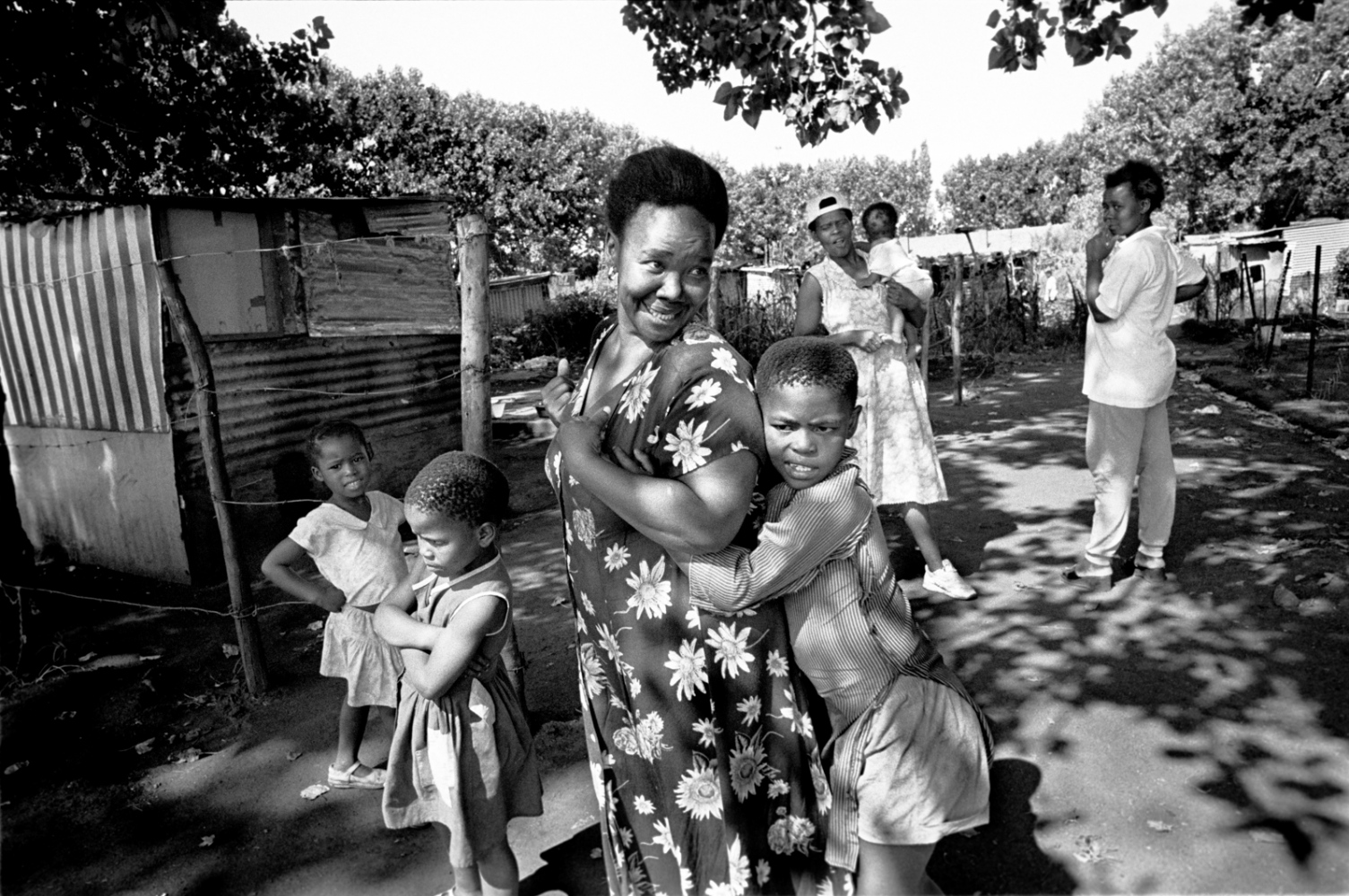 Masindi with her neighbor, who advises her to avoid men, and stay home to help her mother and the other women in the village. 1998