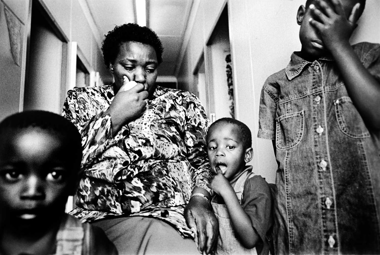A mother cries upon learning that her two young boys have been sexually assaulted by their father. 1998