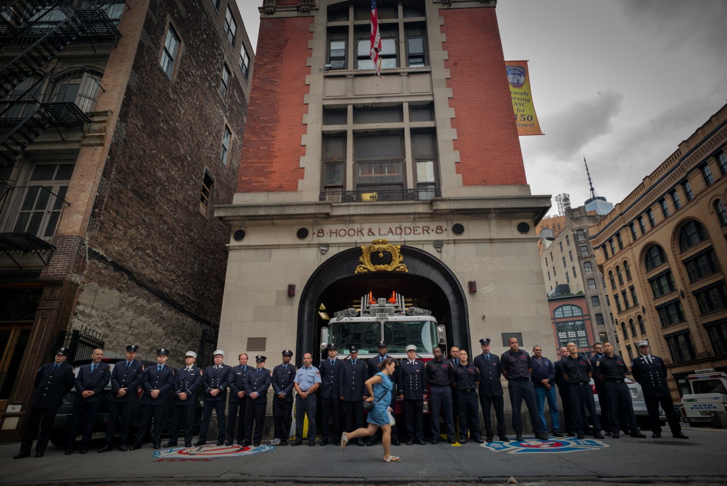 9:15am. Firemen of Ladder House 8 stand in silence every year to remember their comrades who died in the WTC attack, No Moore St, September 11, 2015.