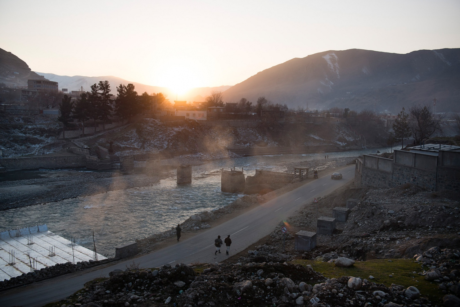 FAIZABAD, AFGHANISTAN | 2014-12-14 | An over view of Kookcha river in the town of Faizabad, just before the sun sets.