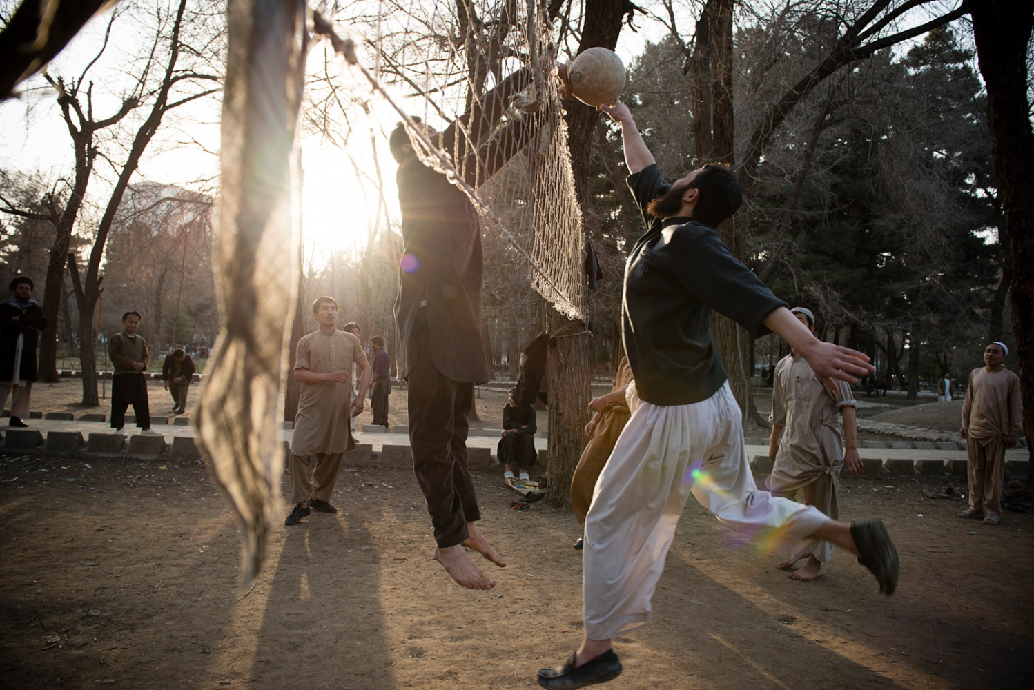 KABUL, AFGHANISTAN | 2015-03-12 | Every Friday the Shahre Now park fills up with hundreds of young afghan men who come to the park to play volleyball, soccer or cricket.