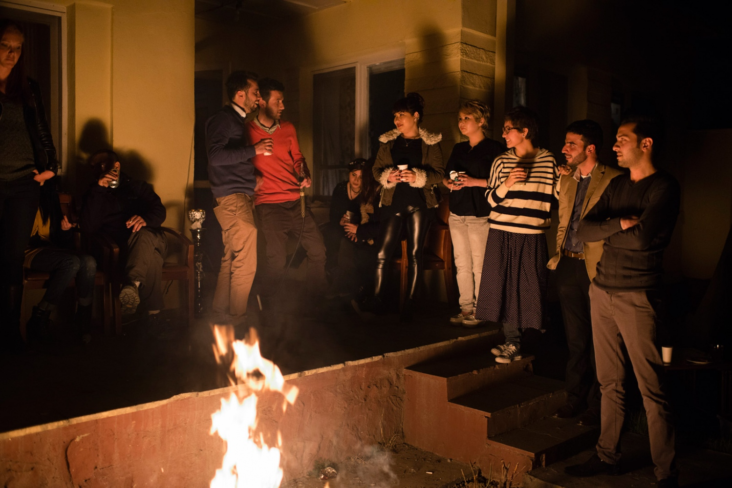 KABUL, AFGHANISTAN | 2015-03-17 | A group of young afghans, mostly raised in iran, gather around the bonfire at a friends backyard to celebrate 'Chahar Shane Soori', the iranian end-of-year fire festival.