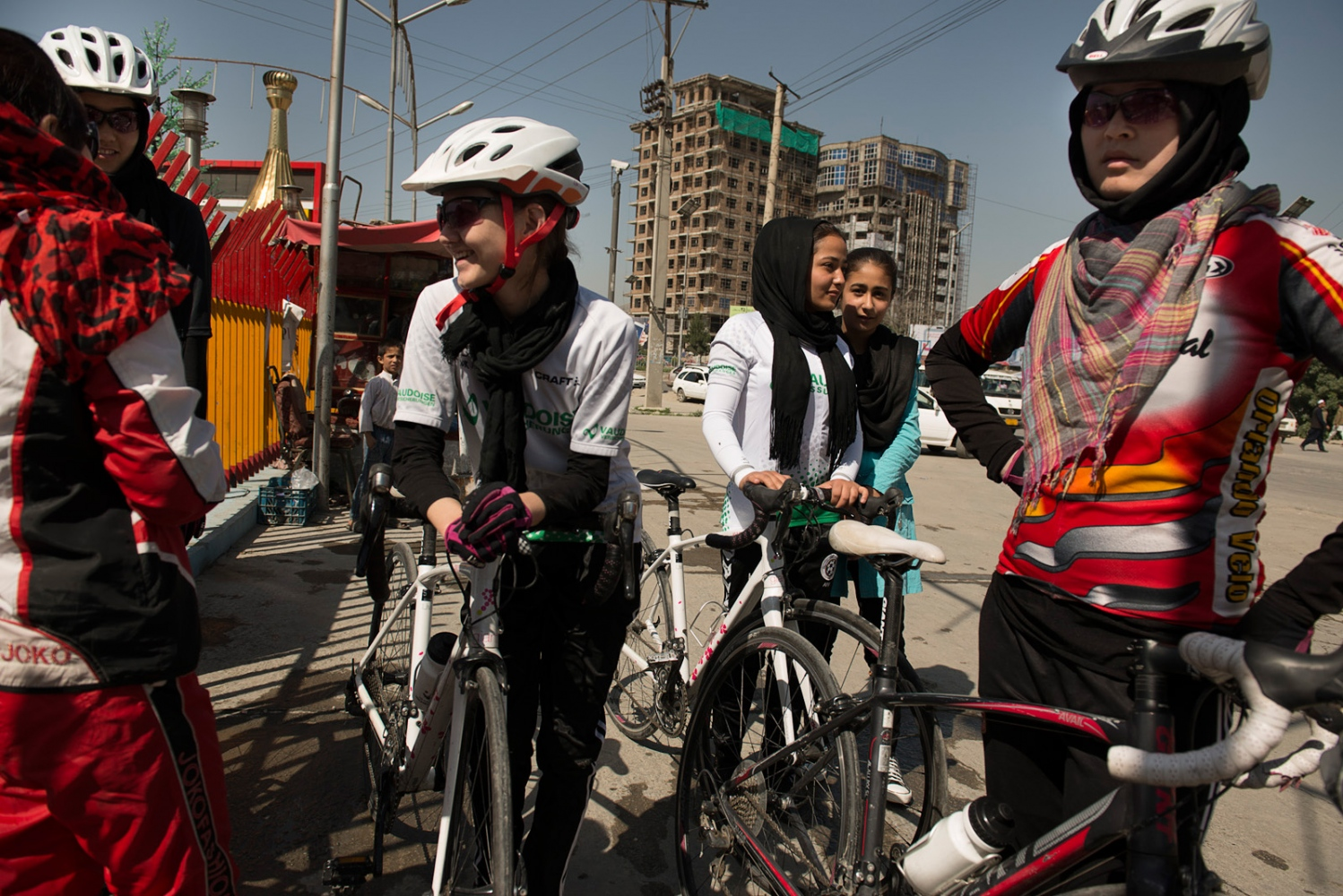 KABUL, AFGHANISTAN | 2015-05-22 | The first female national team of cycling of Afghanistan, made up of 14 to 23 year old brave girls, practice once several times a week just outside of Kabul, cautious for their safety.