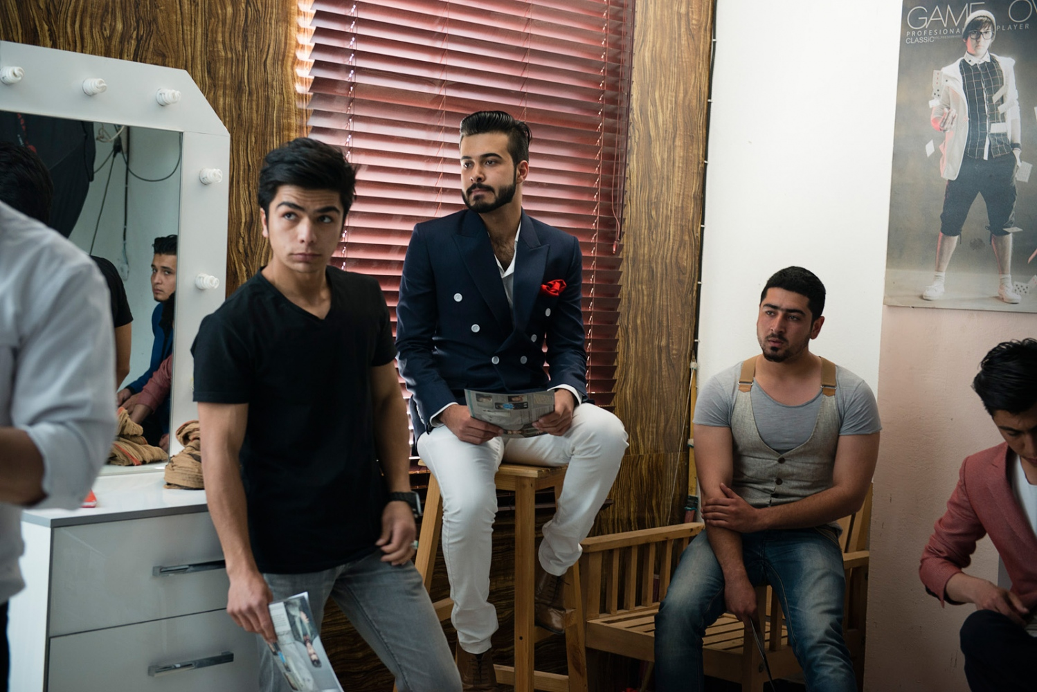 KABUL, AFGHANISTAN | 2015-04-21 | Young Afghan men await their turn to do a trial shoot for a male modelling agency. Inside a small photo studio in Karte 3 neighbourhood, a group of young fashion photographers have come together to organize the first male modelling agency. Hundreds of young afghan men showed up to the audition and only 20 made the cut.