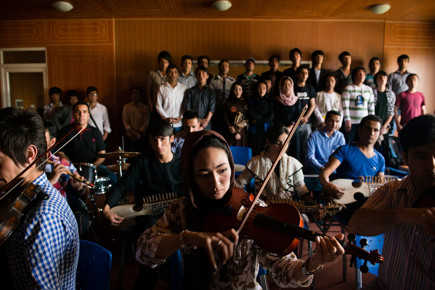 KABUL, AFGHANISTAN | 2015-06-13 | Students at Faculty of Music at Kabul University, some in the classical program, other in traditional music, rehearse together for an upcoming orchestra playing for a national holiday.