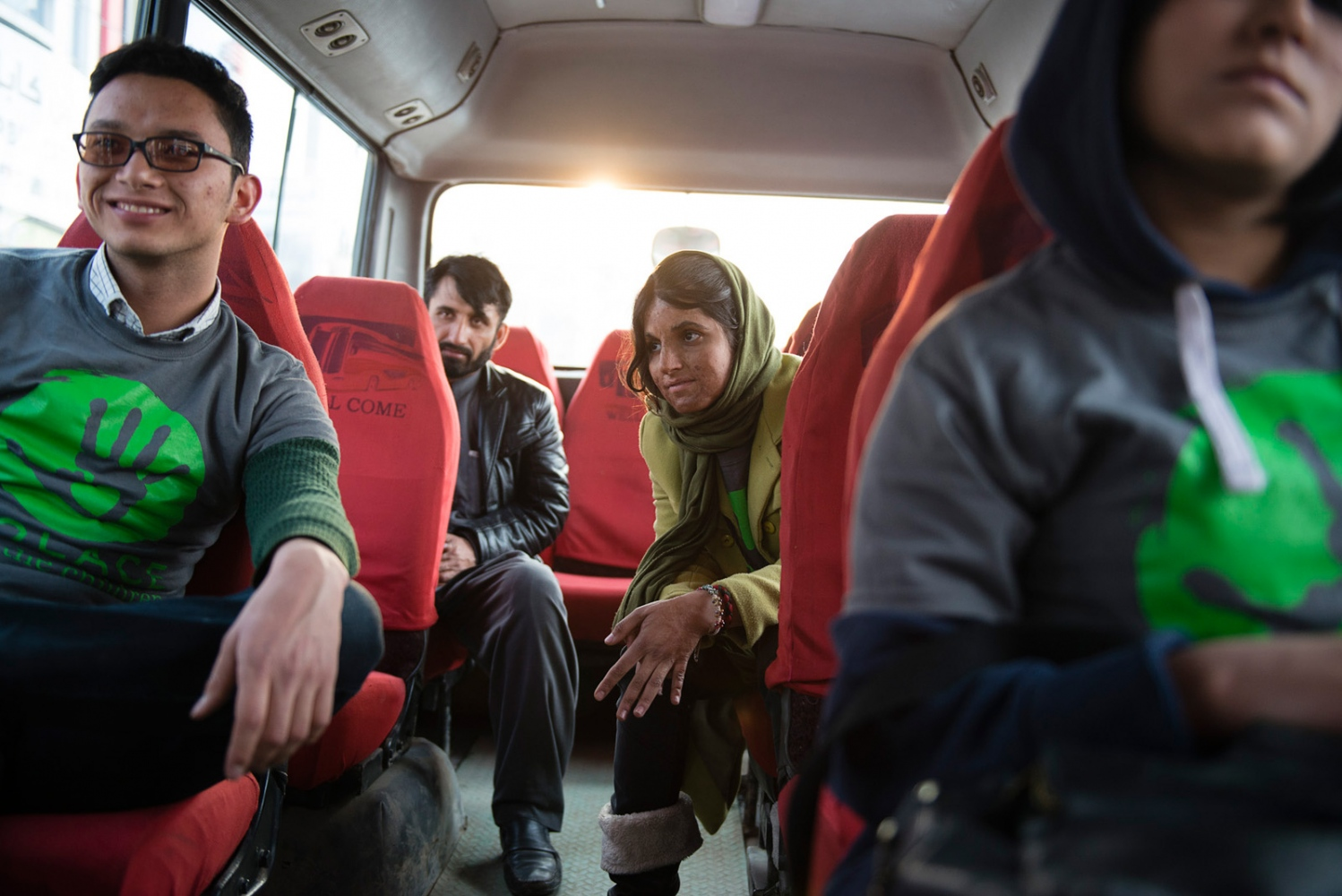 KABUL, AFGHANISTAN | 2015-02-27 | After a long day of distributions, volunteers working with a grassroots afghan NGO, all very young university students, ride a bus back to their base to end their weekly mission, blanket and warm clothes drive to those families in need.