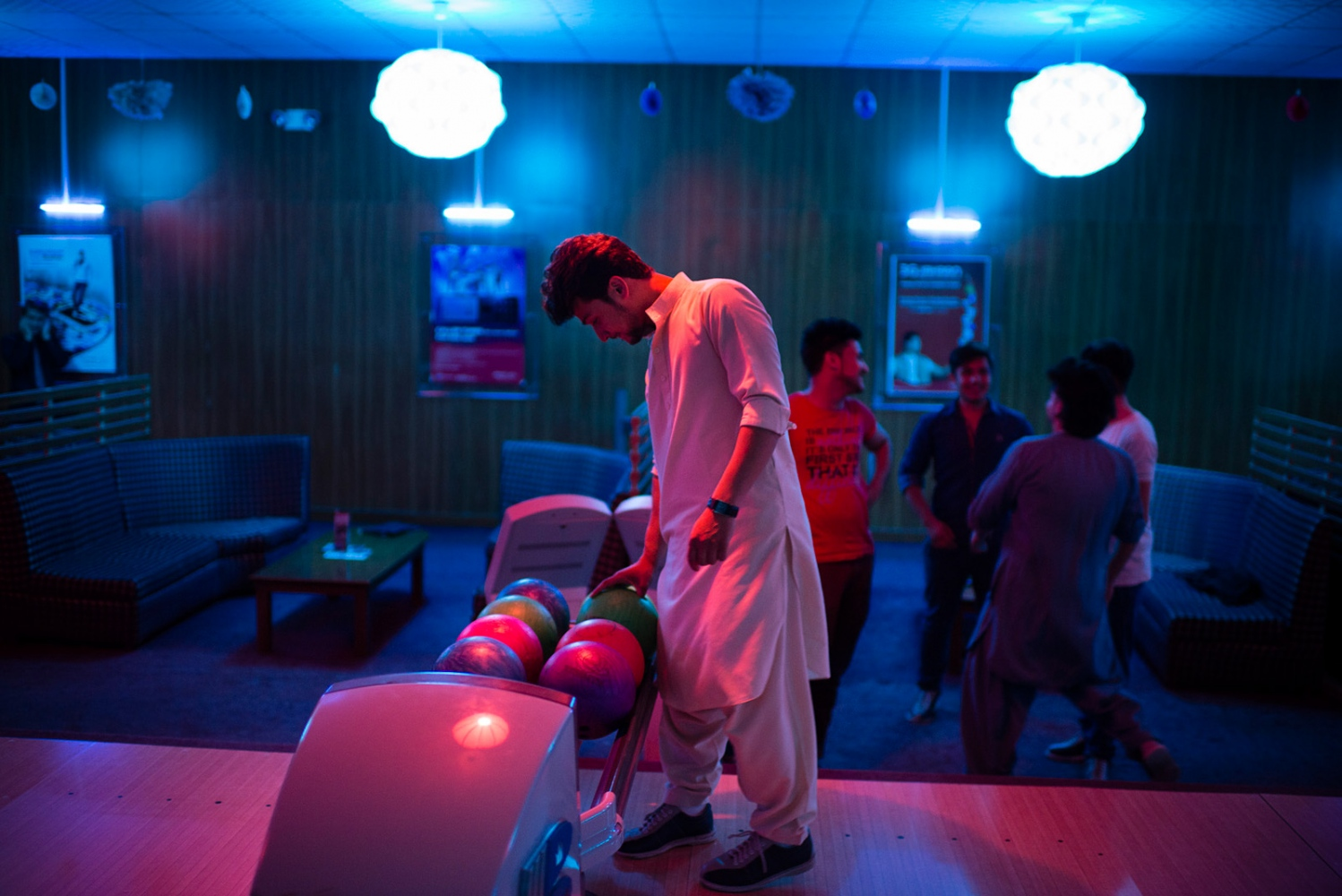 KABUL, AFGHANISTAN | 2015-06-17 | A group of young afghans play bowling at the only bowling club in Kabul, Shahre Now.